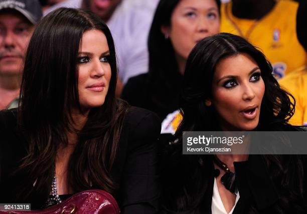 TV personalities Khloe Kardashian and Kim Kardashian watch the season opening game between the Los Angeles Clippers and the Los Angeles Lakers at...