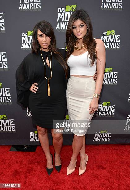 TV personalities Kim Kardashian and Kylie Jenner arrive at the 2013 MTV Movie Awards at Sony Pictures Studios on April 14 2013 in Culver City...