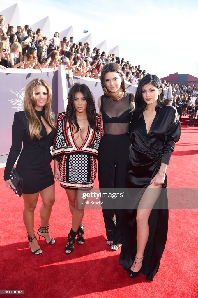 TV personalities Kim Kardashian, Kendall Jenner and Kylie Jenner attend the 2014 MTV Video Music Awards at The Forum on August 24, 2014 in Inglewood, California.