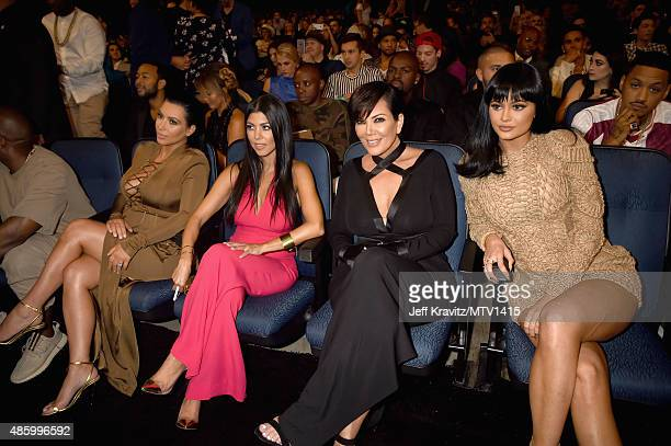 TV personalities Kim Kardashian Kourtney Kardashian Kris Jenner and Kylie Jenner during the 2015 MTV Video Music Awards at Microsoft Theater on...