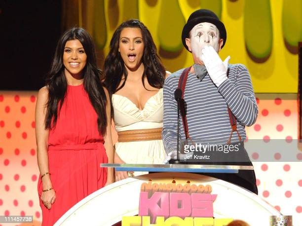 Personalities Kourtney and Kim Kardashian speak onstage during Nickelodeon's 2011 Kids' Choice Awards at Galen Center on April 2 2011 in Los Angeles...