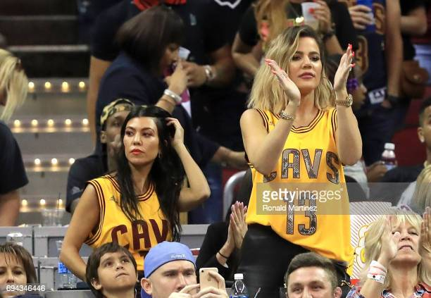 TV personalities Kourtney Kardashian and Khloe Kardashian attend Game 4 of the 2017 NBA Finals between the Golden State Warriors and the Cleveland...