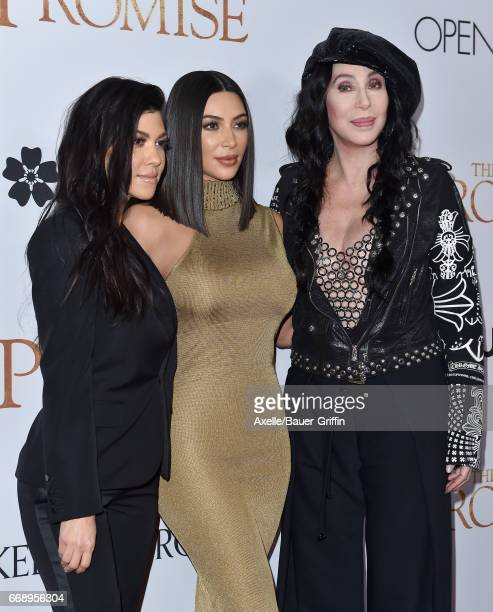 TV personalities Kourtney Kardashian and Kim Kardashian and singer/actress Cher arrive at the Premiere of Open Road Films' 'The Promise' at TCL...