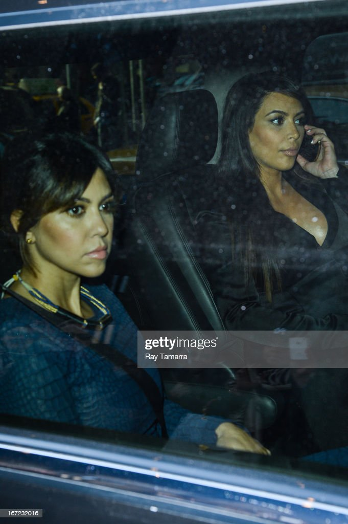 TV personalities Kourtney Kardashian (L) and Kim Kardashian leave their Soho hotel on April 22, 2013 in New York City.