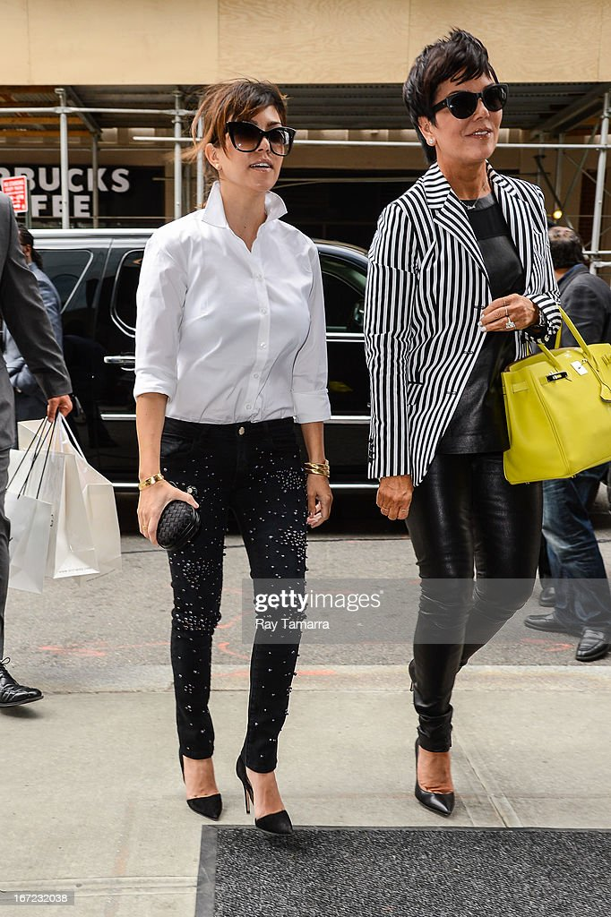 TV personalities Kourtney Kardashian (L) and Kris Jenner enter their Soho hotel on April 22, 2013 in New York City.
