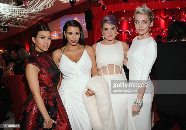 TV Personalities Kourtney Kardashian Kim Kardashian and Kelly Osbourne and actress/singer Miley Cyrus attend the 21st Annual Elton John AIDS...