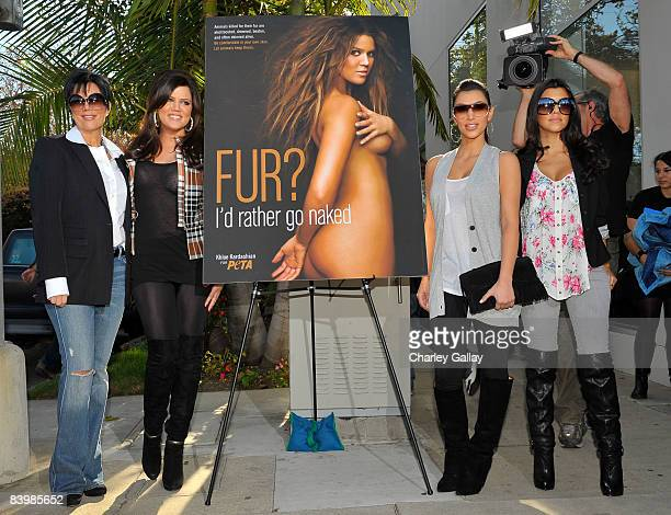 TV personalities Kris Kardashian Khloe Kardashian Kim Kardashian and Kourtney Kardashian pose as Khloe Kardashian unveils her PETA 'Fur I'd Rather Go...