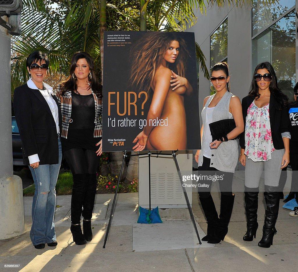 TV personalities Kris Kardashian, Khloe Kardashian, Kim Kardashian, and Kourtney Kardashian pose as Khloe Kardashian unveils her PETA 'Fur? I'd Rather Go Naked' billboard on December 10, 2008 in Los Angeles, California.