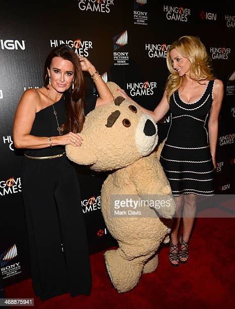 TV personalities Kyle Richards and Camille Grammer with Teddy attend the 'The Hungover Games' cast crew screening at TCL Chinese 6 Theatres on...