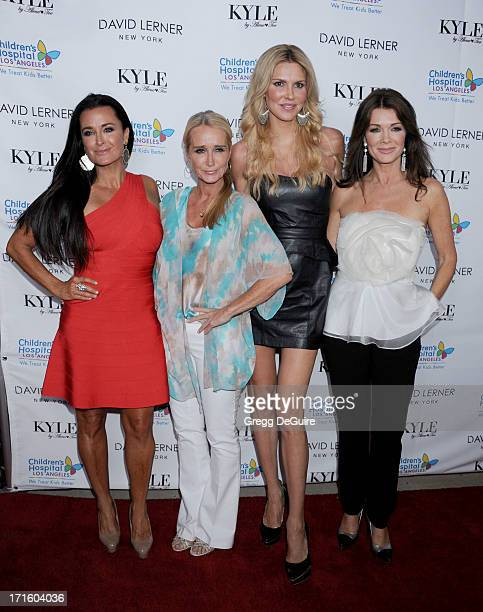 TV personalities Kyle Richards Kim Richards Brandi Glanville and Lisa Vanderpump arrive at a fashion fundraiser hosted by Kyle Richards benefiting...