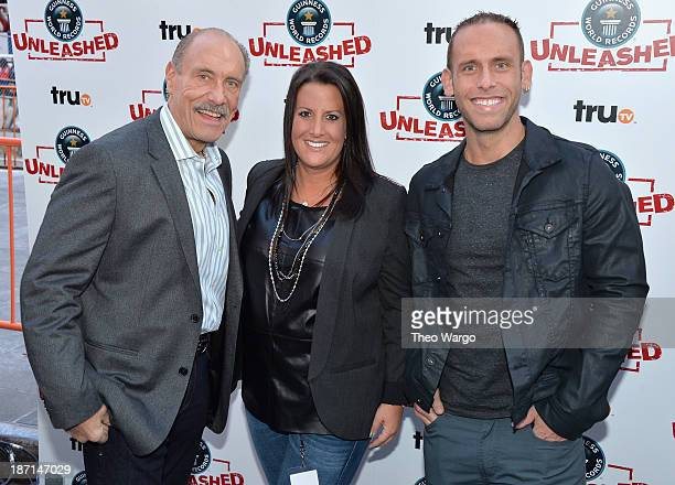 Personalities Les Gold, Ashley Broad, and Seth Gold pose at the Guinness World Records Unleashed Arena in Times Square on November 6, 2013 in New...