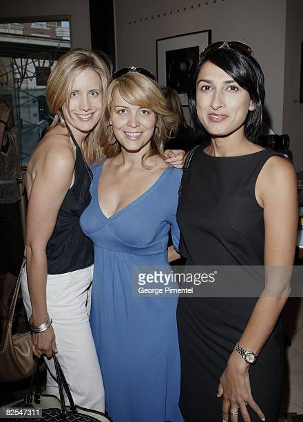Personalities Liza Fromer Martine Gaillard and Robin Gill attend photographer George Pimentel's launch for this photo installation One Shot at the...