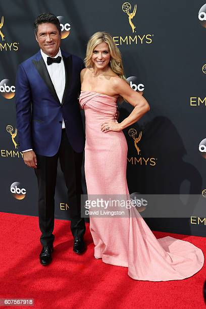 TV personalities Louis Aguirre and Debbie Matenopoulos arrive at the 68th Annual Primetime Emmy Awards at the Microsoft Theater on September 18 2016...