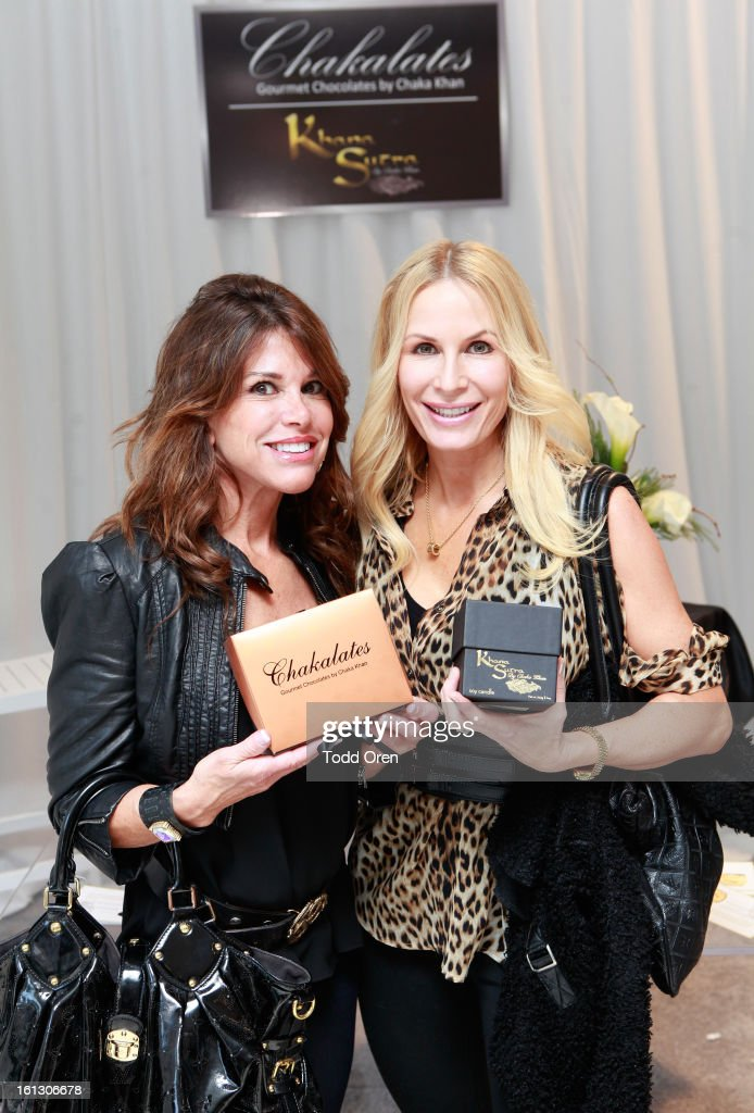 TV personalities Lynne Curtin and Peggy Tanous attend the GRAMMY Gift Lounge during the 55th Annual GRAMMY Awards at STAPLES Center on February 9, 2013 in Los Angeles, California.