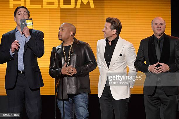 TV personalities Mark Cuban Daymond John Robert Herjavec and Kevin O'Leary speak onstage at the 2014 American Music Awards at Nokia Theatre LA Live...