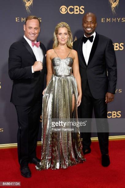 TV personalities Matt Iseman Kristine Leahy and Akbar GbajaBiamila attend the 69th Annual Primetime Emmy Awards at Microsoft Theater on September 17...