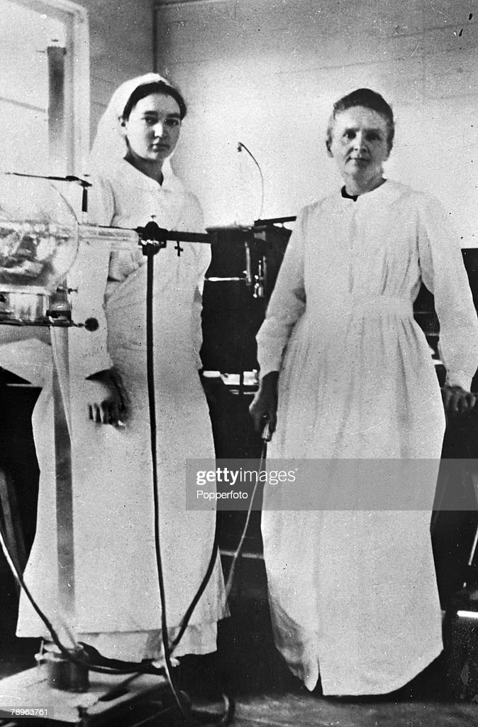 Personalities. Medicine. Science/Health. pic: circa 1915. Marie Curie, (Polish born French Physicist) 1867-1934, pictured with her daughter Irene when they worked as nurses during World War One. Marie Curie won the 1903 Nobel Prize for Physics with husban : News Photo