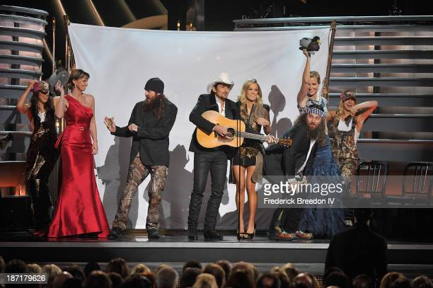 TV Personalities Melissa Robertson Jace Robertson Willie Robertson and Korie Robertson from the hit show Duck Dynasty on stage with Hosts Brad...