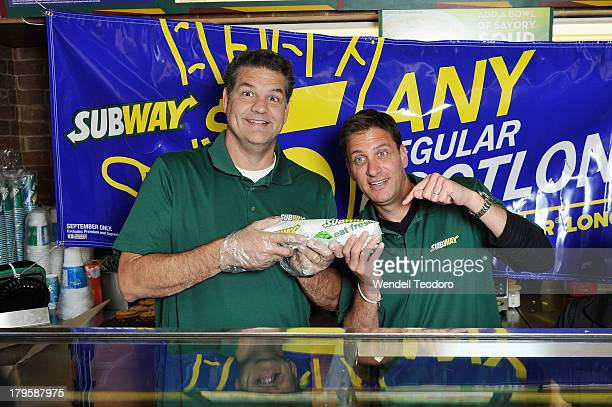 """Personalities Mike Golic and Mike Greenberg attends the """"SUBtember At SUBWAY"""" Launch at Subway Restaurant on September 5, 2013 in New York City."""