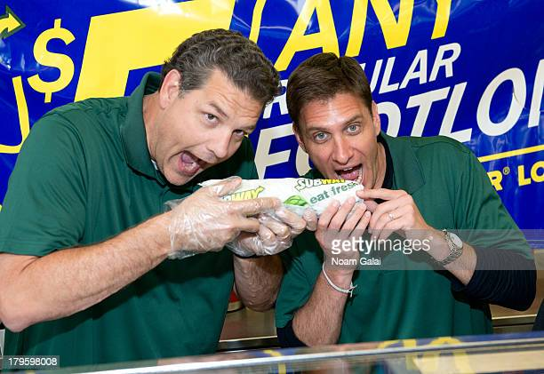 """Personalities Mike Golic and Mike Greenberg promote """"SUBtember at Subway"""" at Subway Restaurant on September 5, 2013 in New York City."""