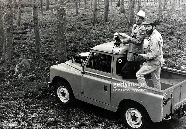 5th April 1966 The Marquess of Bath pictured with an armed guard in the back of a Land Rover at his stately home at Longleat as they carefully watch...
