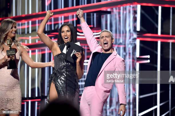 TV personalities Padma Lakshmi and Andy Cohen speak onstage at the 2018 Billboard Music Awards at MGM Grand Garden Arena on May 20 2018 in Las Vegas...