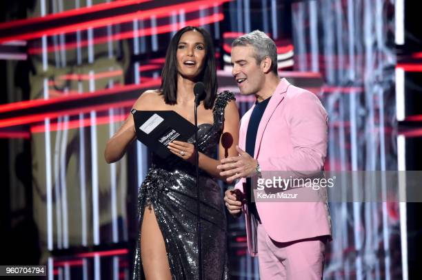 Personalities Padma Lakshmi and Andy Cohen speak onstage at the 2018 Billboard Music Awards at MGM Grand Garden Arena on May 20, 2018 in Las Vegas,...