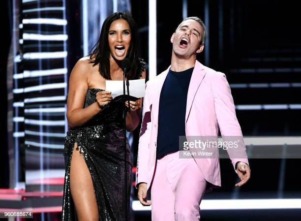 Personalities Padma Lakshmi and Andy Cohen speak onstage during the 2018 Billboard Music Awards at MGM Grand Garden Arena on May 20, 2018 in Las...