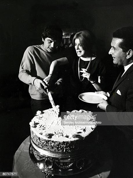 18th August 1965 British photographer David Bailey cuts the wedding cake with his new wife French actress Catherine Deneuve after their wedding at St...