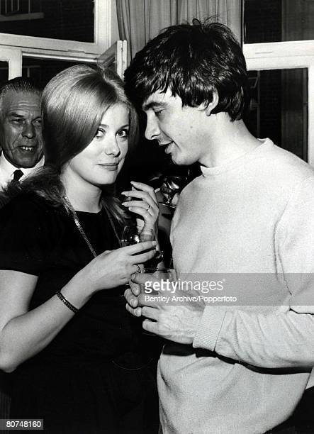 18th August 1965 British photographer David Bailey with his new wife French actress Catherine Deneuve after their wedding at St Pancras Town Hall...