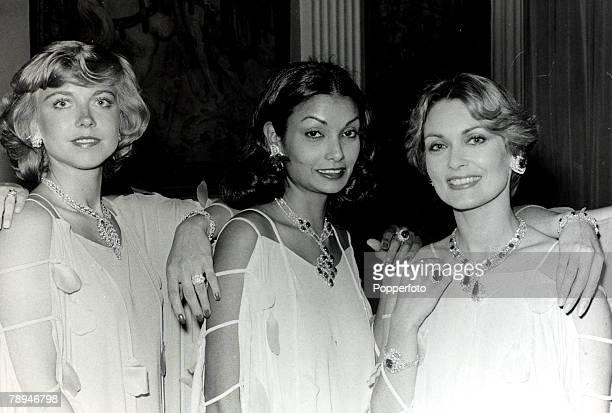 May 1977 Lr Davina Sheffield Shakira Caine Alexandra Bastedo modelling 30000 worth of jewellry at a London fashion show