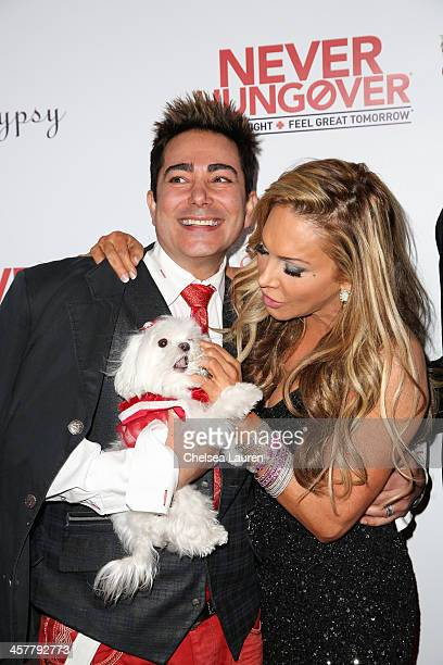 TV personalities Pol' Atteu and Adrienne Maloof arrive at The Maloof Foundation and Jacob's Peter W Busch family foundation holiday toy donation on...