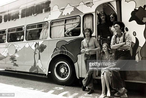 21st July 1972 Paul McCartney right his wife Linda and his group 'Wings' with their double decker bus as they prepare for the road on their 'Wings...