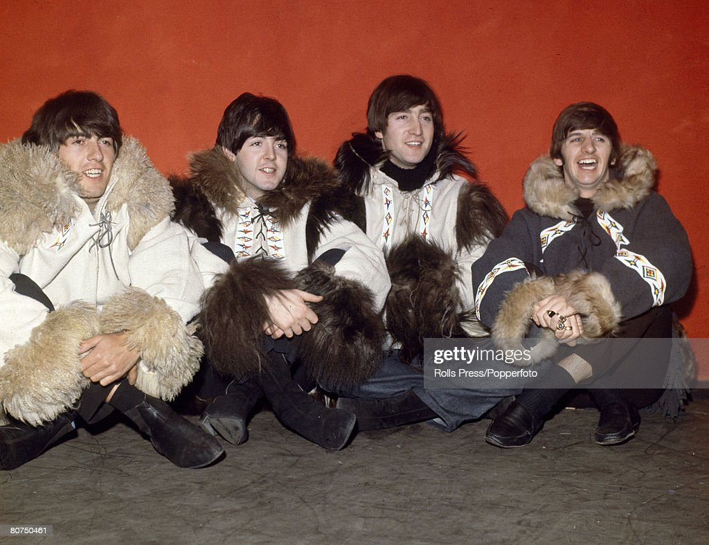 Personalities Pop Music. pic: December 1964. London. The Beatles group, left-right, George Harrison, Paul McCartney, John Lennon and Ringo Starr pose in Eskimo coats at the Hammersmith Odeon. : News Photo