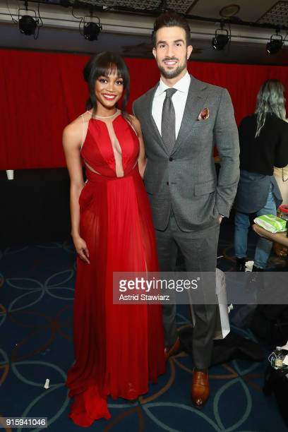 TV personalities Rachel Lindsay and Bryan Abasolo pose backstage at the American Heart Association's Go Red For Women Red Dress Collection 2018...