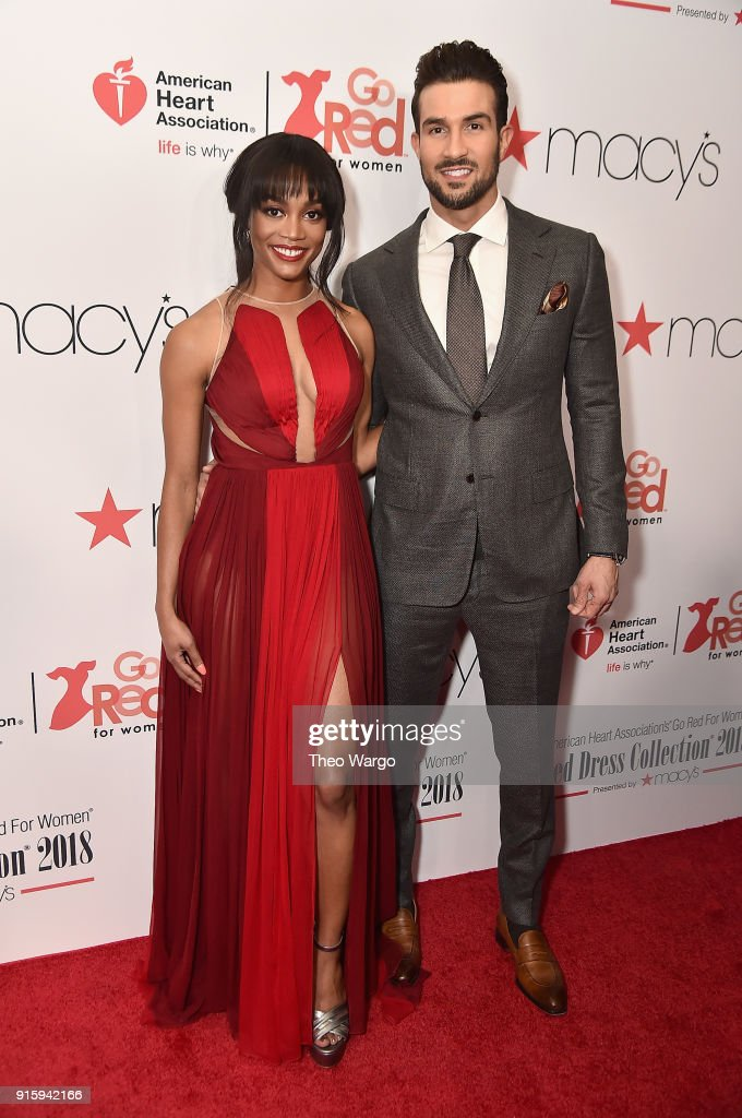 TV personalities Rachel Lindsay (L) and Bryan Abasolo pose backstage at the American Heart Association's Go Red For Women Red Dress Collection 2018 presented by Macy's at Hammerstein Ballroom on February 8, 2018 in New York City.