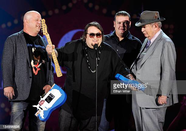 Personalities Rick Harrison, Austin 'Chumlee' Russell, Corey Harrison and Richard Harrison of 'Pawn Stars' speak onstage at the American Country...