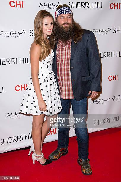 TV personalities Sadie Robertson and Willie Robertson attend the Evening By Sherri Hill Spring 2014 show at Trump Tower on September 9 2013 in New...