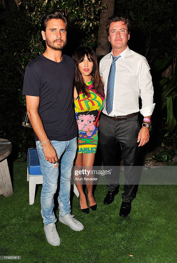 TV personalities Scott Disick and Kourtney Kardashian along with Wildfox CEO and President Jimmy Sommers attend the Wildfox Swim Cruise 2014 VIP BBQ at Soho Beach House on July 21, 2013 in Miami Beach, Florida.