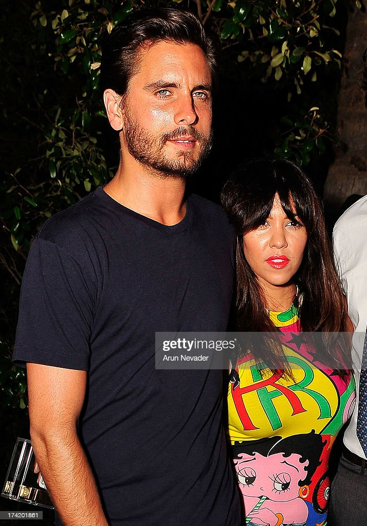 TV personalities Scott Disick and Kourtney Kardashian attend the Wildfox Swim Cruise 2014 VIP BBQ at Soho Beach House on July 21, 2013 in Miami Beach, Florida.
