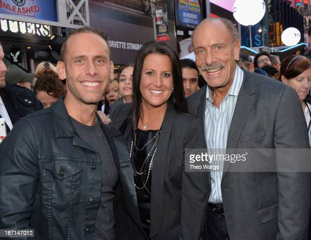 TV personalities Seth Gold Ashley Broad and Les Gold pose at the Guinness World Records Unleashed Arena in Times Square on November 6 2013 in New...