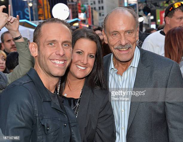 Personalities Seth Gold, Ashley Broad, and Les Gold pose at the Guinness World Records Unleashed Arena in Times Square on November 6, 2013 in New...