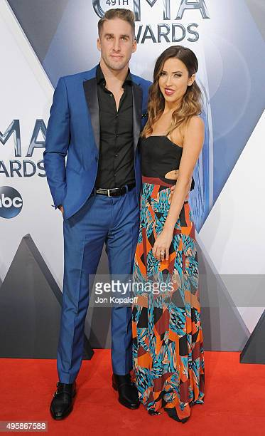 TV personalities Shawn Booth and Kaitlyn Bristowe attend the 49th annual CMA Awards at the Bridgestone Arena on November 4 2015 in Nashville Tennessee