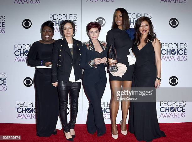 TV personalities Sheryl Underwood Sara Gilbert Sharon Osbourne Aisha Tyler and Julie Chen pose with an award in the press room during the People's...
