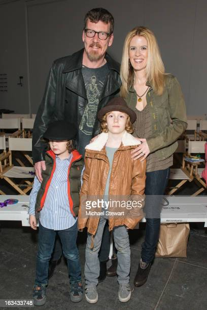 TV personalities Simon van Kempen and Alex McCord with children attend the Diesel Kids fashion show during 2013 petitePARADE Kids Fashion Week at...