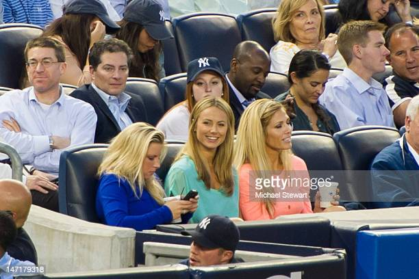 TV personalities Stacy Keibler and Torrie Wilson attends the Cleveland Indians vs New York Yankees game at Yankee Stadium on June 26 2012 in New York...
