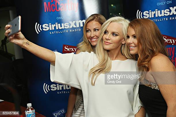 Personalities Stephanie Hollman and Brandi Redmond pose for a photo with host Jenny McCarthy during a visit to 'Dirty, Sexy, Funny with Jenny...