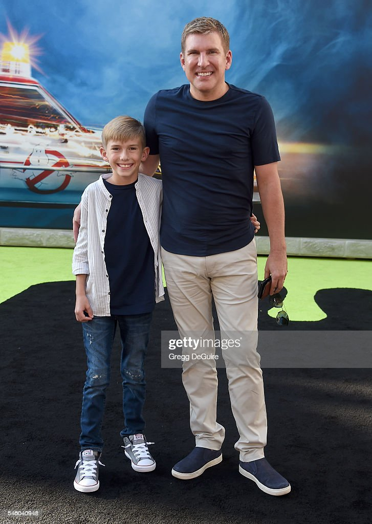 TV personalities Todd Chrisley and son Grayson Chrisley arrive at the premiere of Sony Pictures' 'Ghostbusters' at TCL Chinese Theatre on July 9, 2016 in Hollywood, California.