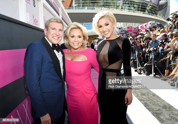 TV personalities Todd Chrisley Julie Chrisley and Savannah Chrisley attend the 52nd Academy Of Country Music Awards at Toshiba Plaza on April 2 2017...