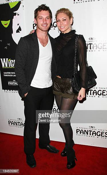 TV personalities Tristan MacManus and Kym Johnson attend the opening night of Wicked at the Pantages Theatre on December 1 2011 in Hollywood...